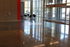 The lobby flooring and common space flooring on eight levels at The Richards Group building features Bomanite VitraFlor custom polished concrete, which was selected to provide durability while adding a modern and sophisticated aesthetic that enhances the design throughout.