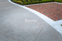 Our colleague Bomanite Toronto earned the Best Bomanite Exposed Aggregate Project Silver Award for their expert installation of Bomanite Sandscape Texture to create this stunning front driveway, providing durability and ease of maintenance while complementing the home's exterior.