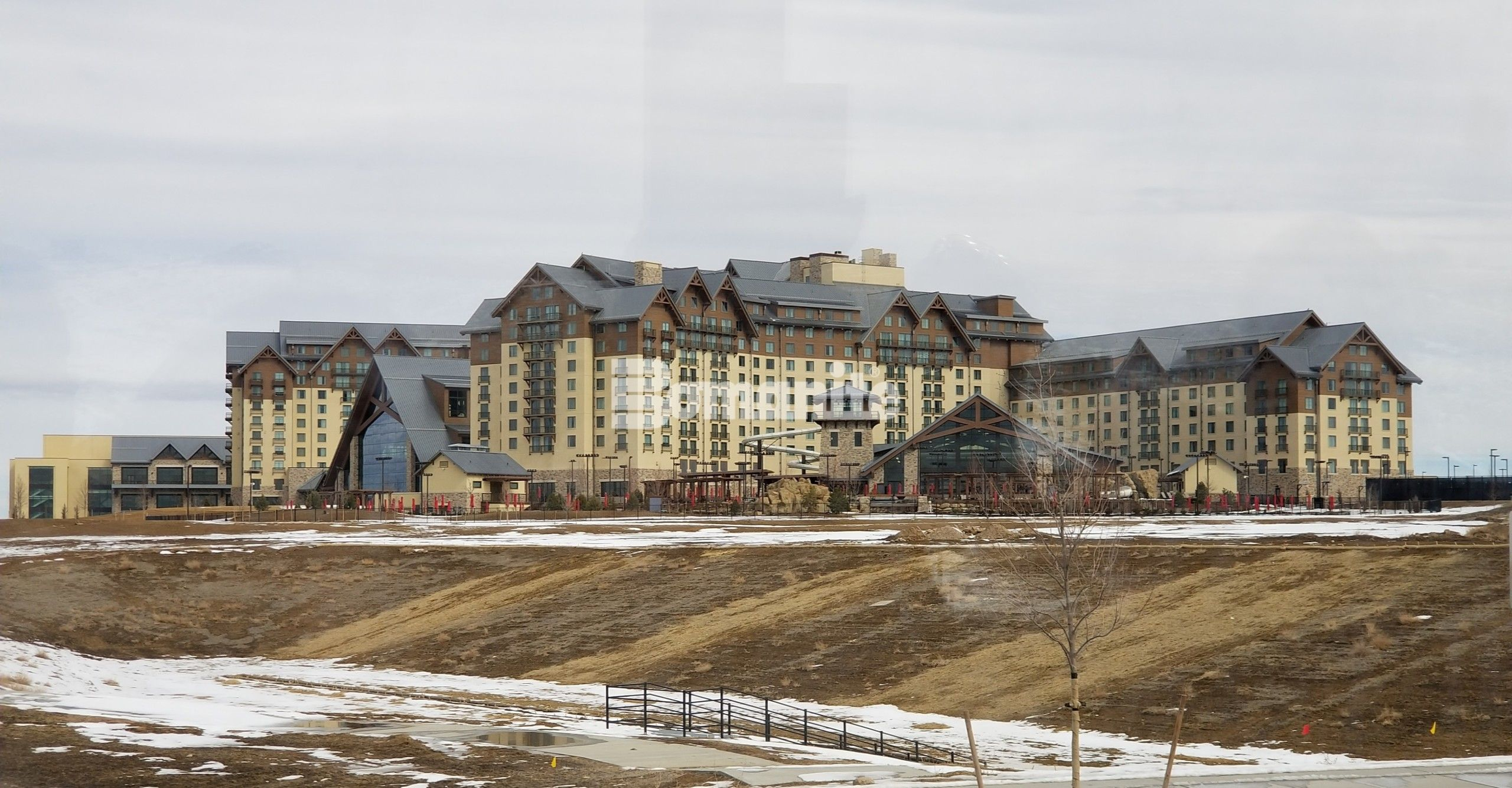Gaylord Rockies Resort & Convention Center designed to look like an alpine lodge on a huge scale is enhanced with Bomanite Imprint and Bomanite Sandscape Texture decorative concrete in Aurora, CO installed by Colorado Hardscapes.