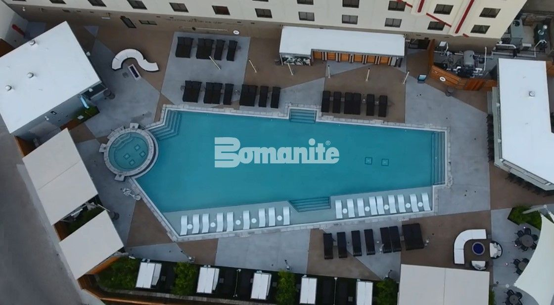 Overhead view of Hark Rock Casino located in Tulsa, OK, with Bomanite Exposed Aggregate Alloy decorative concrete installed on the pool deck by Bomanite of Tulsa.