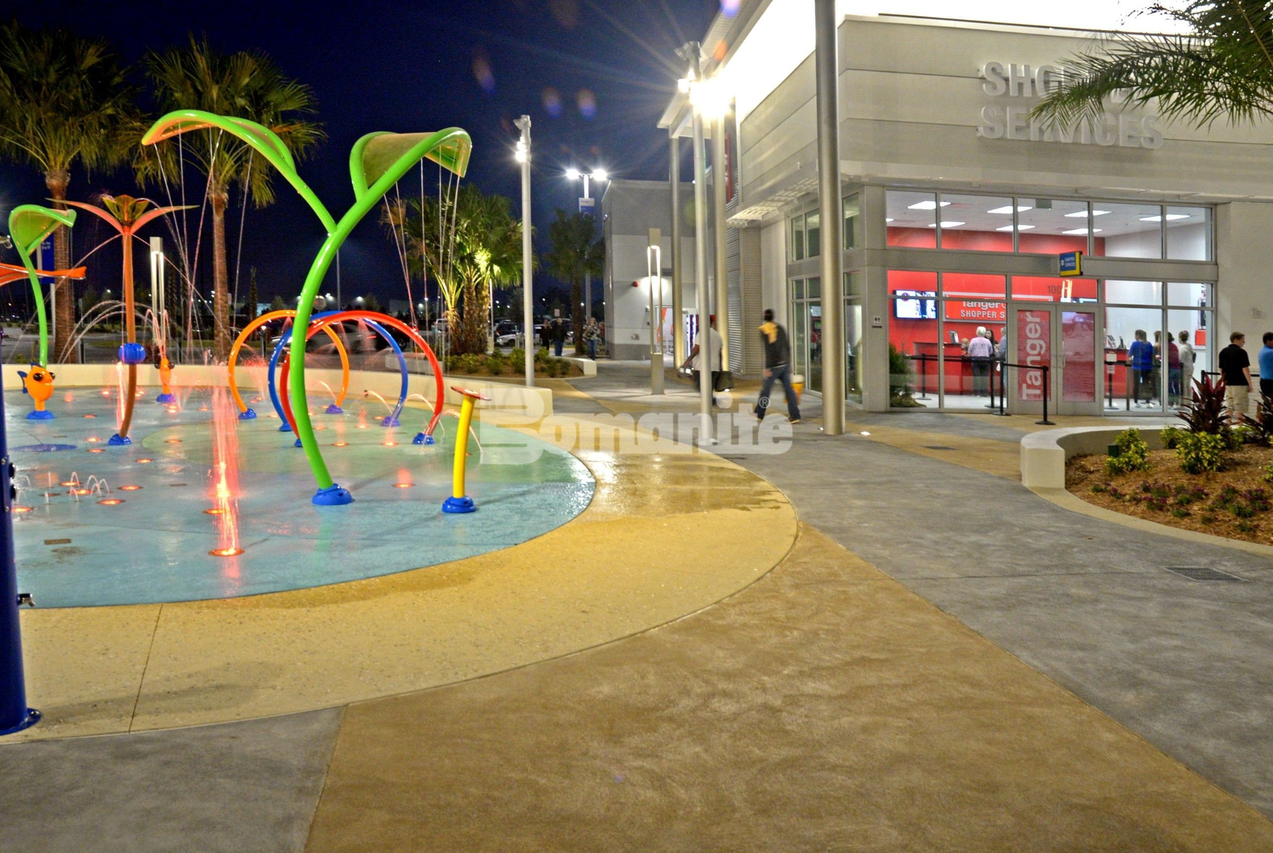 Tanger Outlet Daytona Beach creates Bomanite Decorative Concrete splash pads to mimic the ocean and sand beach vibe installed by Bomanite Licensee Edwards Concrete Company located in Winter Garden, FL.