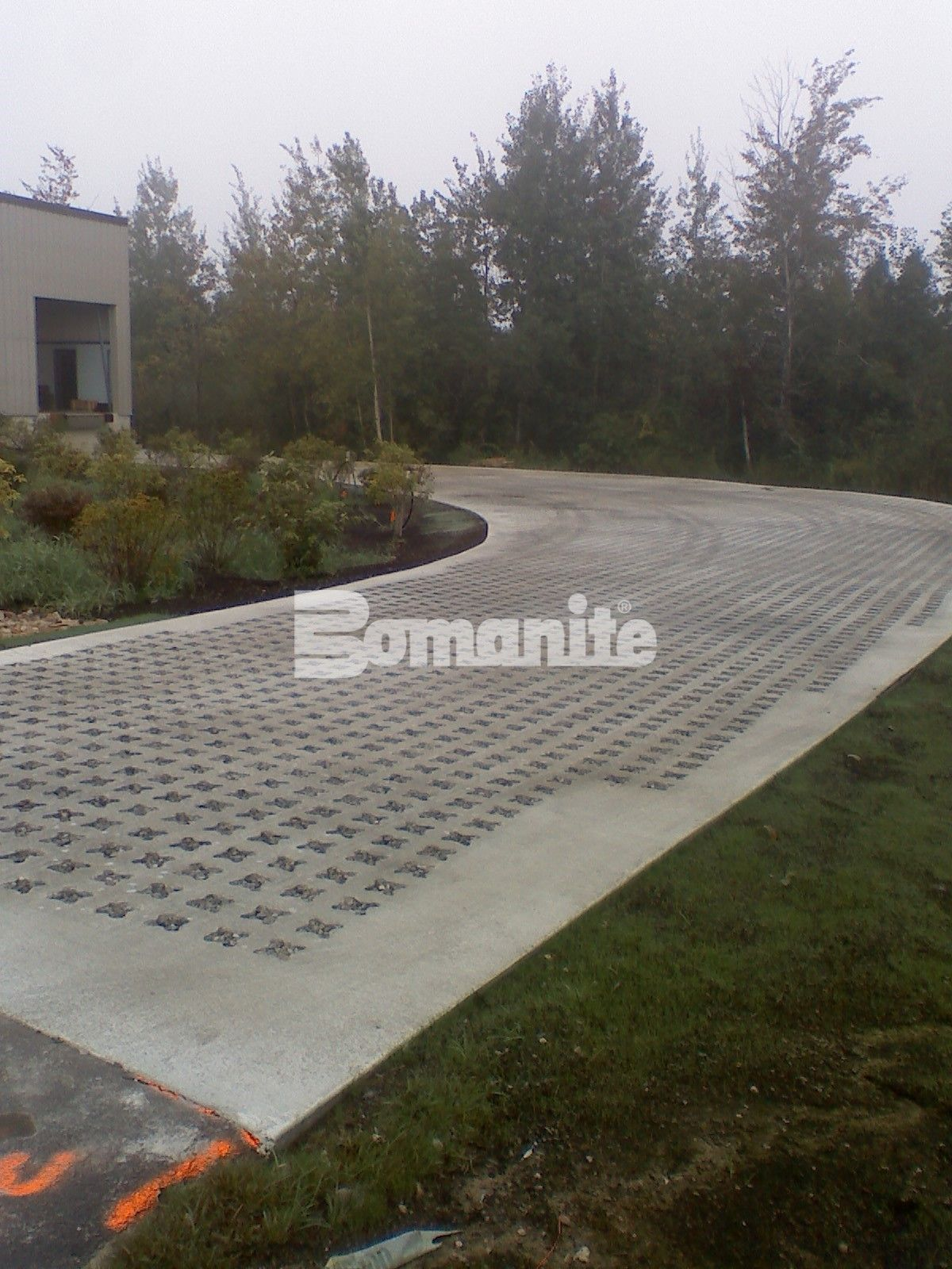 Grasscrete Stone Filled System is robust enough for a 40,000 lb loaded truck access road that was created to withstand the heavy load deliveries at Micronics headquartered in Portsmouth New Hampshire installed by Premier Concrete Construction.