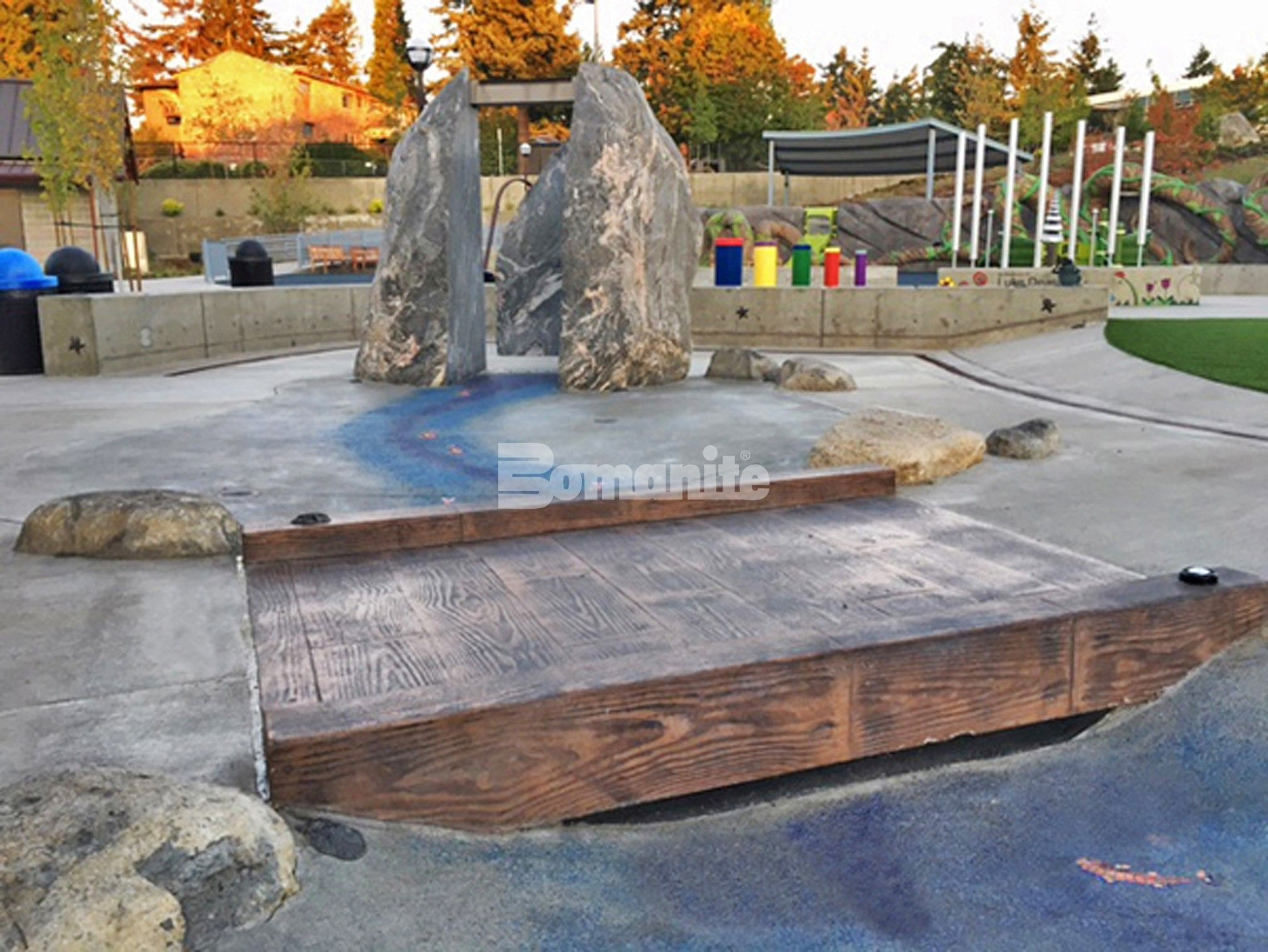 Splash Pad at Downtown Bellevue Park Designs Inspiration Playground using Bomanite Decorative Concrete from Belarde Company, Washington forming a Concrete Bridge for the Splash Pad.