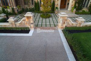 Checkerboard courtyard entry of residence with decoractive concrete using Bomanite Exposed Aggregate Deep Washed Sandscape Texture installed by Bomanite Toronto to withstand the Canadian Winters.